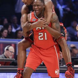 Miami Heat's Chris Bosh, left, celebrates with Dominique Wilkins, center during the NBA All-Star Saturday Shooting Starts event Saturday, Feb. 14, 2015, in New York.  (AP Photo/Frank Franklin II)