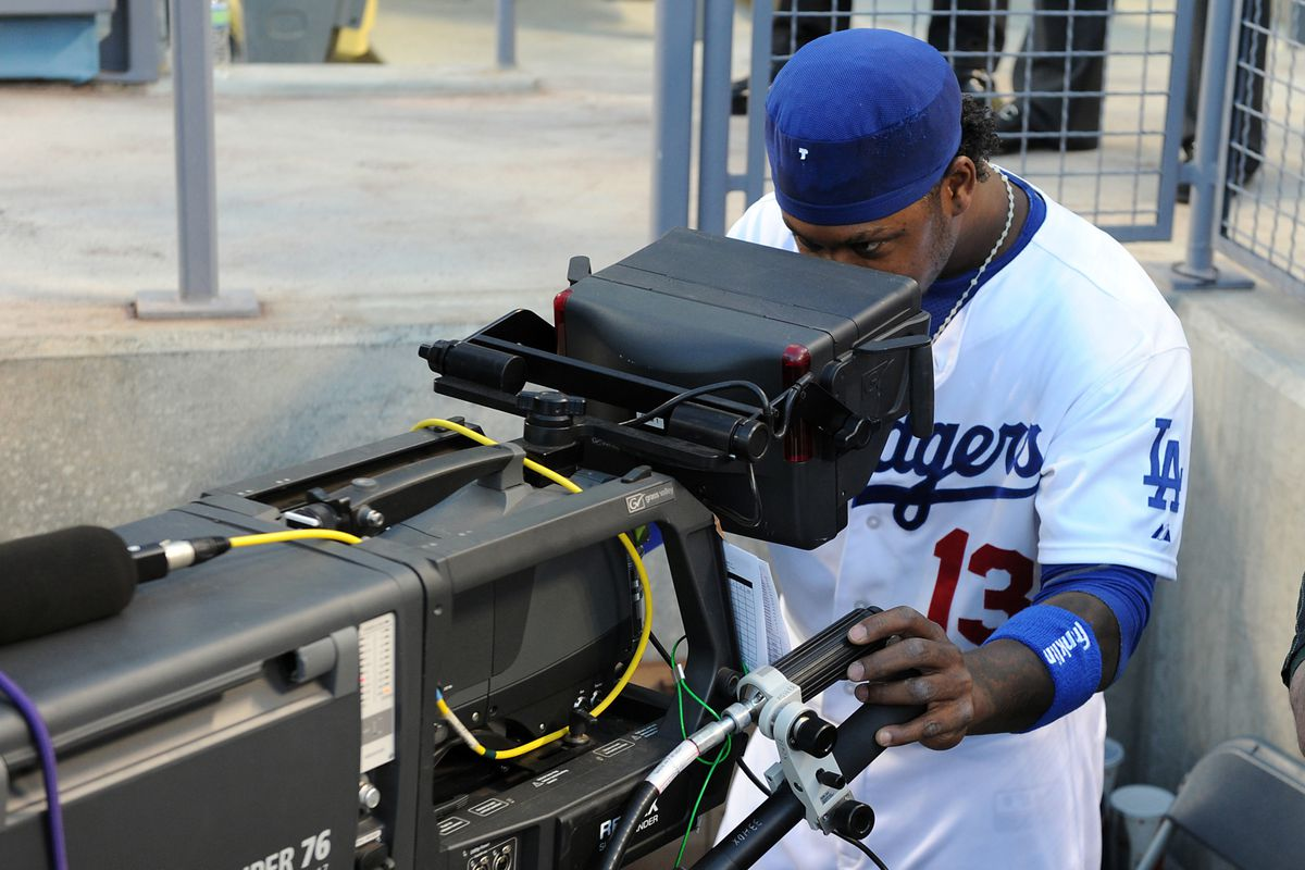 No, the Dodgers have not made Hanley Ramirez pull double duty as a TV camera operator.