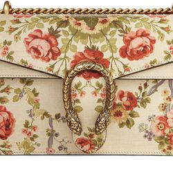 Gucci's signature Dionysus shoulder bag with the 19th-century floral tapestry print. This is the medium size.