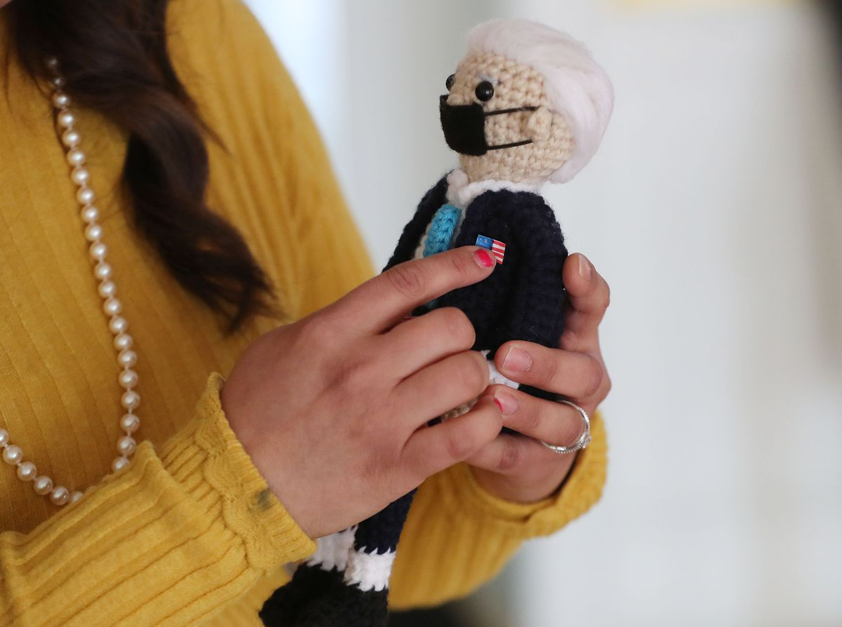 Vicky Chavez, who for three years has sought sanctuary with her young daughters at the First Unitarian Church of Salt Lake City, holds a doll of President Joe Biden she crocheted on Wednesday, March 24, 2021. Chavez and three other women in similar situations in other states are suing U.S. immigration officials, alleging they are facing steep fines because they spoke out about their cases.