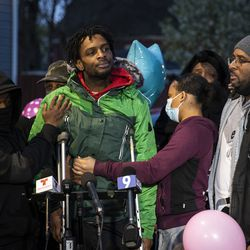 Flanked by family members and supporters who helped hold him up, Jontae Adams speaks to reporters as dozens gather for a vigil for his 7-year-old daughter, Jaslyn Adams, outside the girl's grandmother's West Side home, Wednesday evening, April 21, 2021. Jaslyn was fatally shot Sunday, April 18, while in line at a McDonald's drive-thru with her father, Jontae Adams, who suffered one gunshot wound to the back and survived. Jontae Adams was released Tuesday from Stroger Hospital.