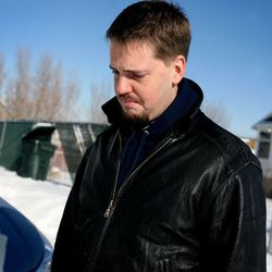 Josh Powell, the husband of Susan Powell, answers questions outside his West Valley home on Dec. 10, 2009.
