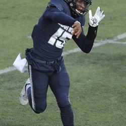 Utah State Aggies quarterback Jason Shelley (15) passes in Logan on Saturday, Nov. 14, 2020.