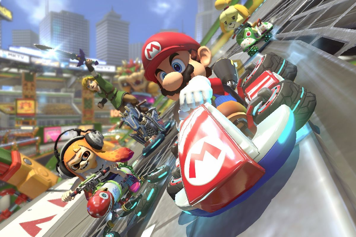 Mario, Isabelle, Splatoon Kid, and Link race in a screenshot from Mario Kart 8 Deluxe