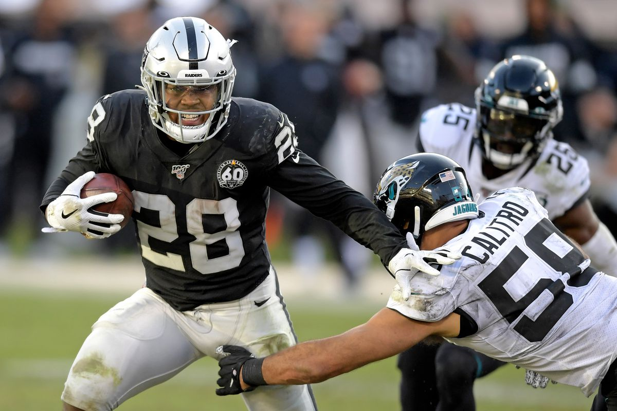 Oakland Raiders running back Josh Jacobs is tackled by Jacksonville Jaguars outside linebacker Austin Calitro during the Raiders final game at the Oakland-Alameda Coliseum before relocating to Las Vegas for the 2020 season. The Jaguars defeated the Raiders 20-16.