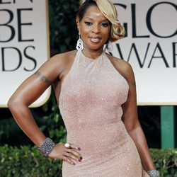 """FILE - In this Jan. 15, 2012 file photo, singer Mary J. Blige arrives at the 69th Annual Golden Globe Awards in Los Angeles. A criticized Burger King commercial featuring Mary J. Blige singing about chicken has been pulled, but the fast-food chain is blaming licensing issues for the decision. In it, Blige sings passionately about the ingredients in the chicken snack wraps. But as the video went viral, some in the black community criticized the ad as stereotypical. The black women-oriented website Madame Noire likened it to """"buffoonery."""" Burger King said Tuesday the commercial was pulled because of a music licensing concern and that they hope to have the Blige """"ads back on the air soon."""""""