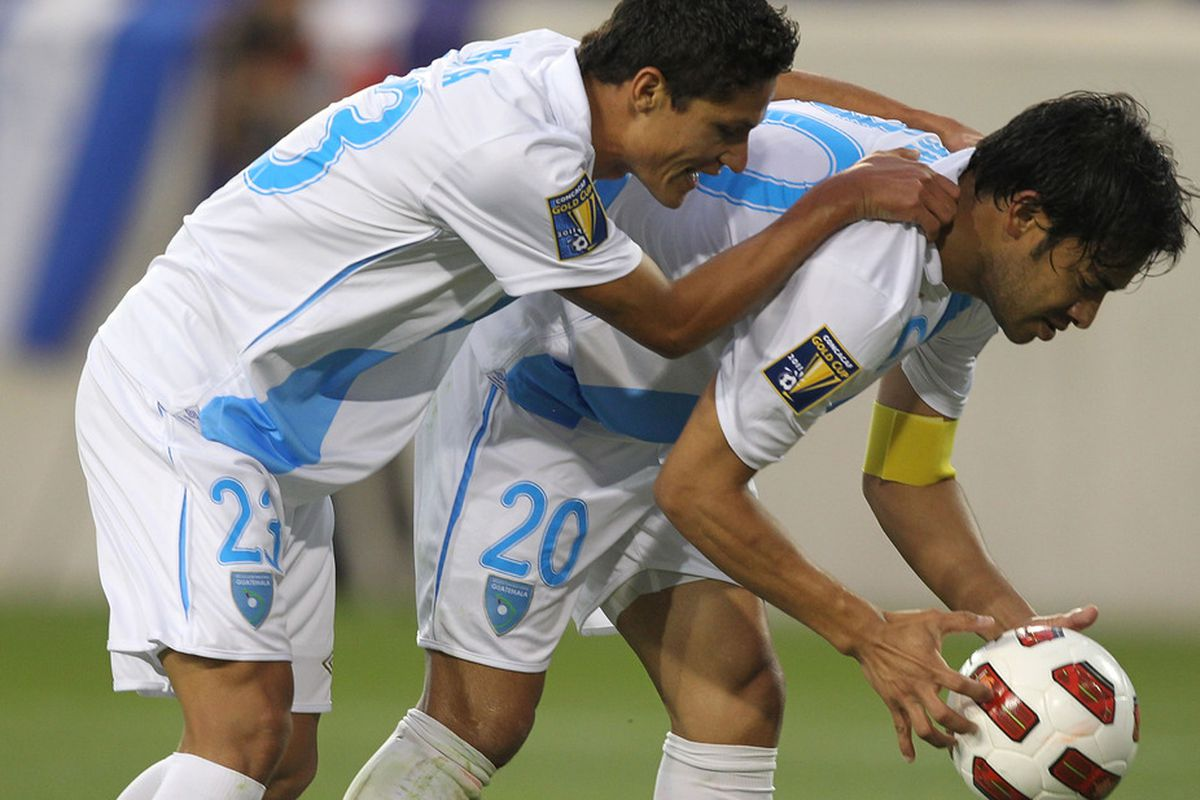 HARRISON, NJ - JUNE 13:  Carlos Ruiz #20 of Guatemala celebrates his goal with Jairo Arreola #23 against Grenada during the Concaf Gold Cup at Red Bull Arena on June 13, 2011 in Harrison, New Jersey.  (Photo by Al Bello/Getty Images)