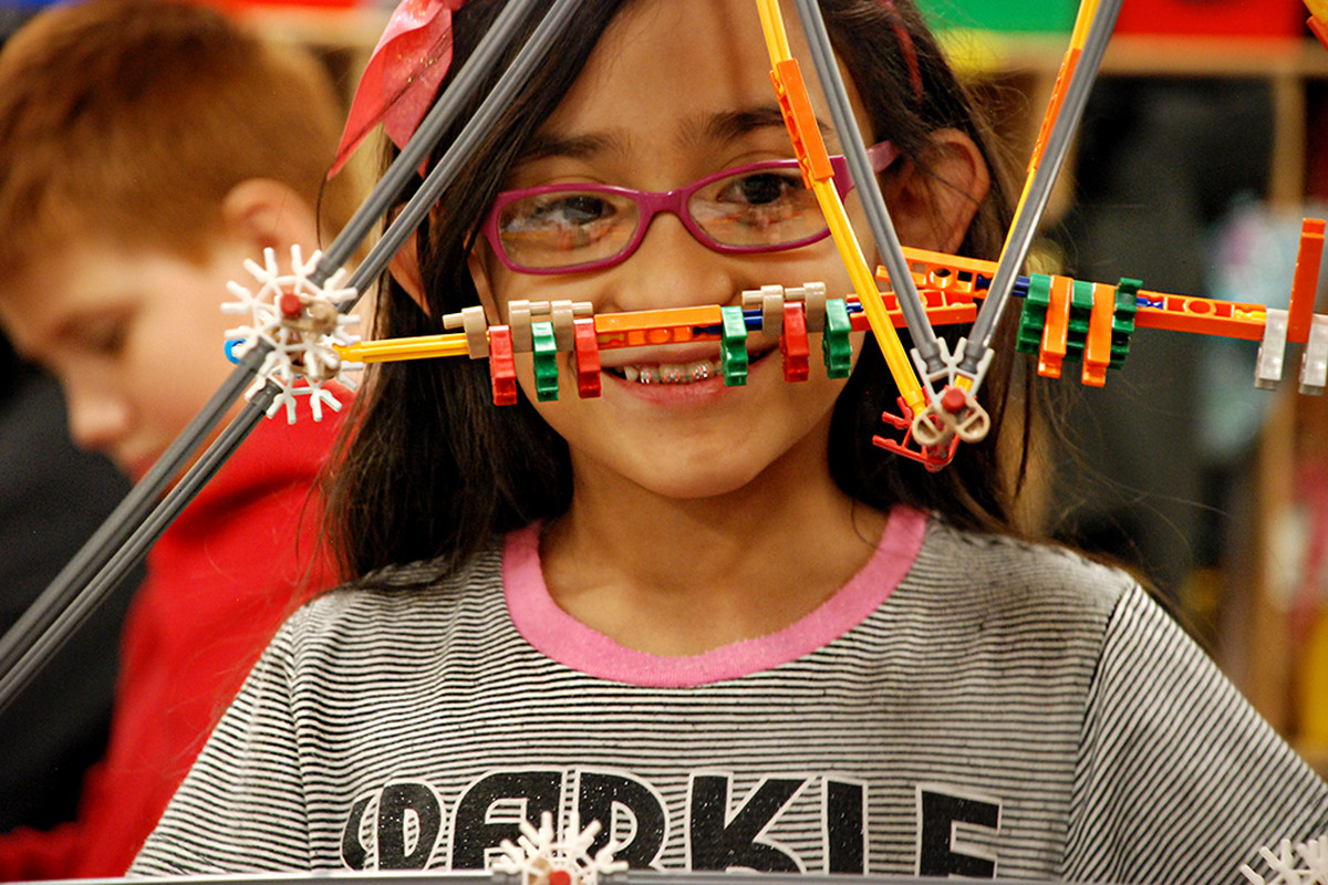 A student at Indian Peaks Elementary School works on a project in class.