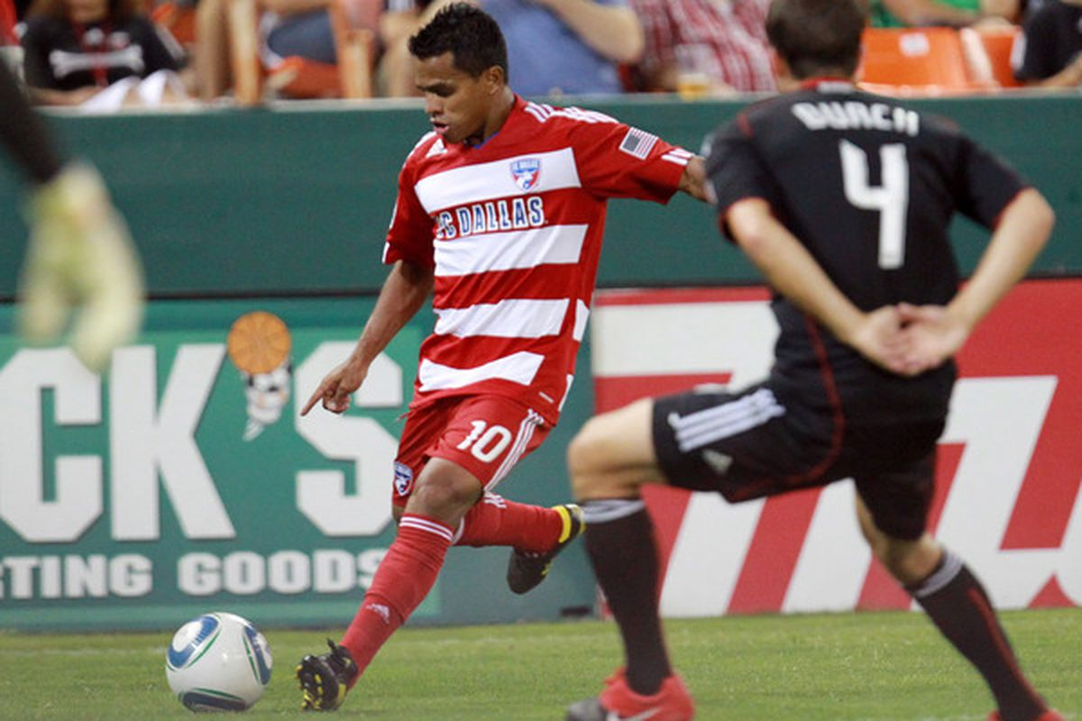 WASHINGTON - AUGUST 14: David Ferreira #10 of FC Dallas shoots the ball against Marc Burch #4 of D.C. United at RFK Stadium on August 14 2010 in Washington DC. (Photo by Ned Dishman/Getty Images)