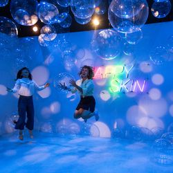 Yee Seon Chae, left, and Kathryn Jankowski, both from WIUX student radio, play in Clinique's bounce house at the Refinery29 pop-up 29Rooms. | Erin Brown/Sun-Times