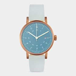 """David Ericsson blue-and-rose gold Horizon watch, $225 at <a href=""""http://www.momastore.org/museum/moma/ProductDisplay_Blue%20And%20Rose%20Gold%20Horizon%20Watch_10451_10001_172602_-1_26715_11502_172637"""">MoMA</a>."""
