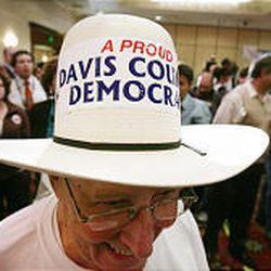 Bob Van Velkinburgh of the Davis County Democratic Party mingles on election night.