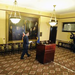 Utah Attorney General John Swallow walks to the podium to announce his resignation at a press conference at the Capitol in Salt Lake City on Thursday, Nov. 21, 2013.