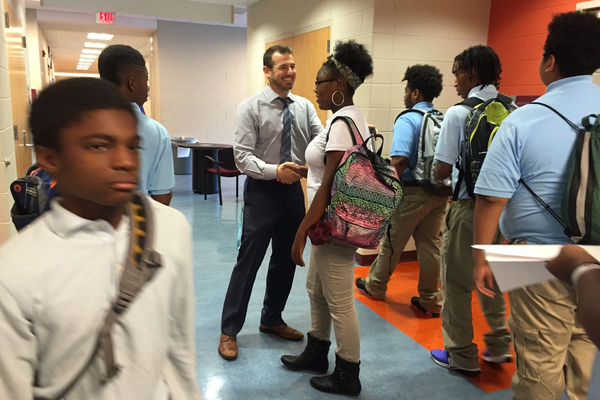 Mumford Academy Principal Nir Saar greets students on the first day of school in 2016.
