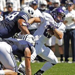 Weber State Wildcats running back C.J. Tuckett (22) runs during the first half as Brigham Young University plays Weber State University in football  Saturday, Sept. 8, 2012, in Provo, Utah.