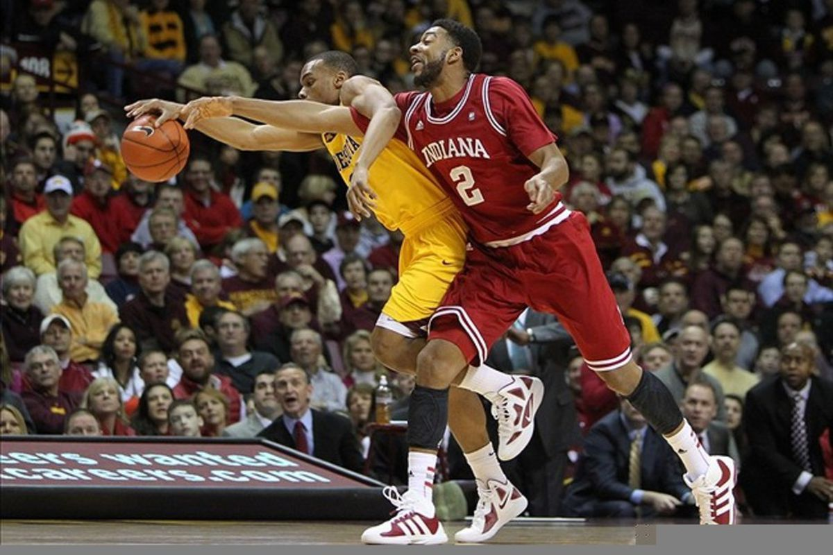 Feb 26, 2012; Minneapolis, MN, USA; Minnesota Golden Gophers guard Andre Hollins (1) protects the ball from Indiana Hoosiers forward Christian Watford (2) during the first half at Williams Arena. Mandatory Credit: Brace Hemmelgarn-US PRESSWIRE