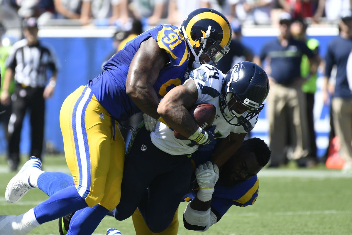 Los Angeles Rams DE Dominique Easley tackles Seattle Seahawks RB Thomas Rawls during the Rams' Week 2 9-3 win, September 18, 2016.