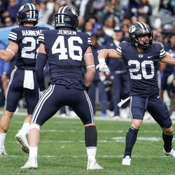BYU players celebrate against Boise State during an NCAA college football game at LaVell Edwards Stadium in Provo on Saturday, Oct. 9, 2021.