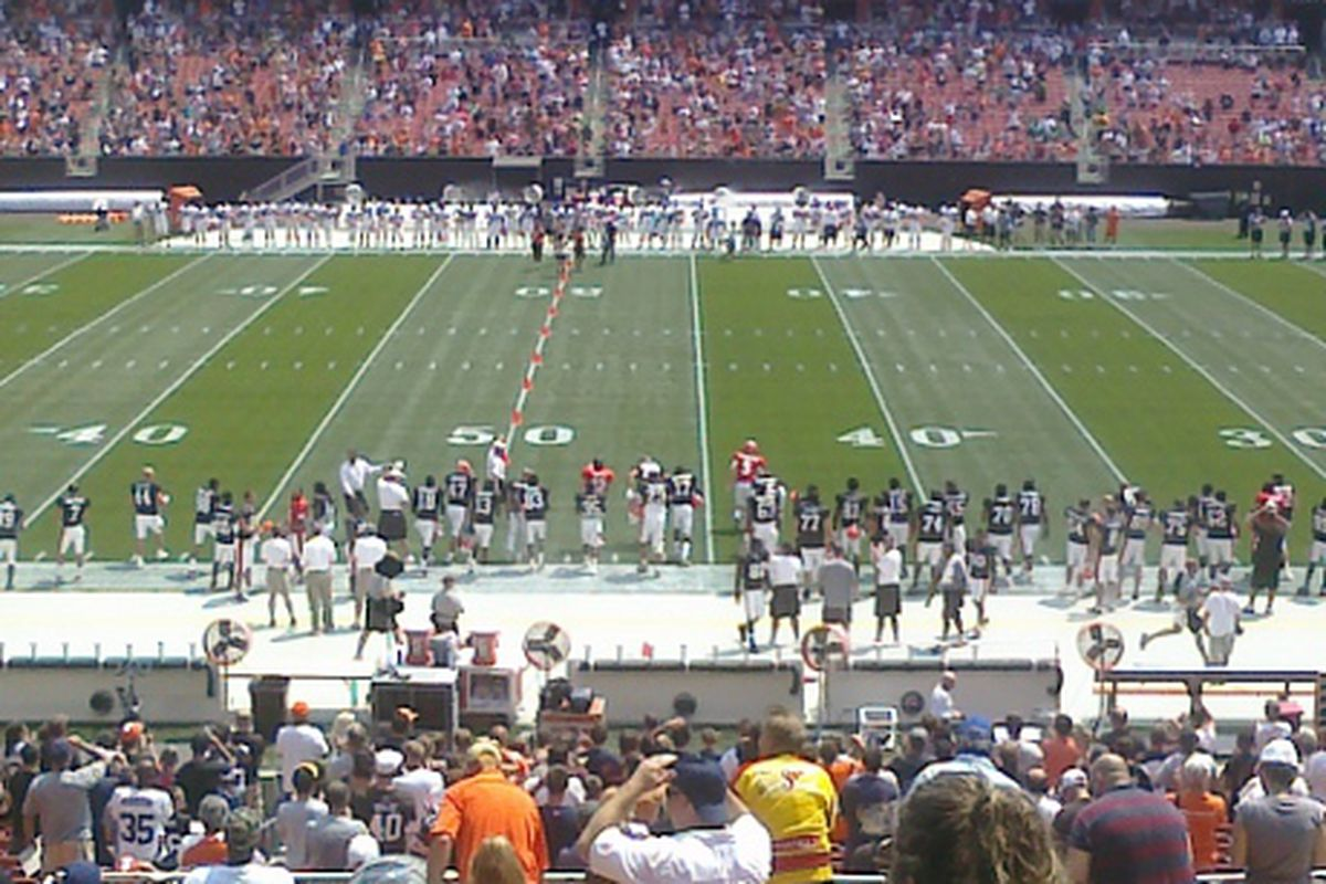 The players getting ready to start practice as the national anthem concludes at Cleveland Browns Family Fun Day.
