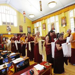 Members of the Tibetan Buddhist Temple participate in annual Prayers for Compassion celebrations in Salt Lake City Thursday, July 3, 2014. The three-day festival offers members of the Salt Lake community a chance to observe, support and participate in a beautiful around-the-clock ritual generating compassion and loving-kindness on behalf of all sentient beings.