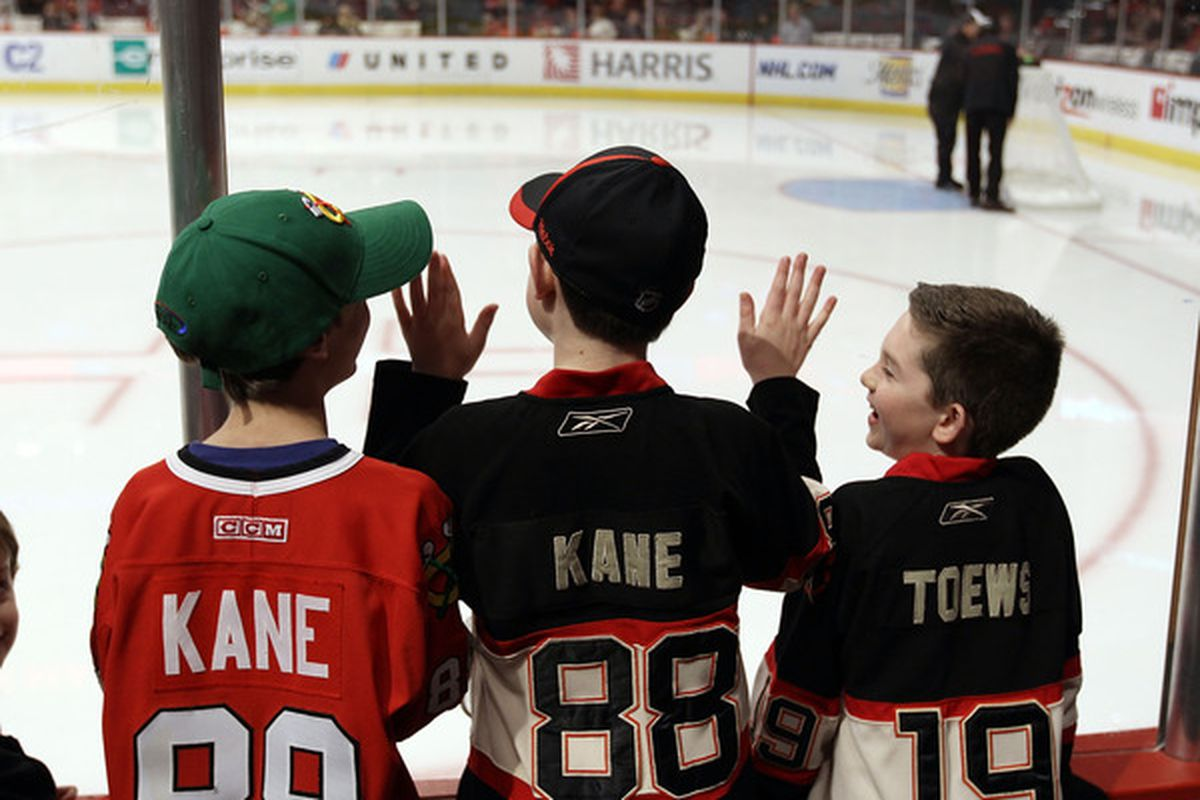 Fans line the glass during warmups looking for pucks prior to the game between the Chicago Blackhawks and the Florida Panthers at the United Center in Chicago, Illinois.  (Photo by Bruce Bennett/Getty Images)