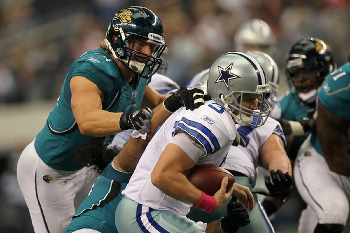 ARLINGTON TX - OCTOBER 31:  Quarterback Jon Kitna #3 of the Dallas Cowboys is sacked by Tyson Alualu #93 (obscured by Kitna) of the Jacksonville Jaguars at Cowboys Stadium on October 31 2010 in Arlington Texas.  (Photo by Stephen Dunn/Getty Images)