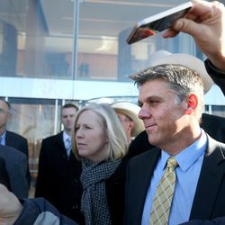 San Juan County Commissioner Phil Lyman, rights, listens to his attorney speak to reporters at the federal courthouse on Friday, Dec. 18, 2015, in Salt Lake City. Lyman was sentenced to 10 days in jail and three years of probation for an illegal ATV protest ride in a southern Utah canyon.