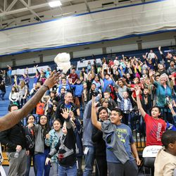 People crowd around as Salt Lake City Stars guard Jaylen Bland (2) tosses out t-shirts after the game against the Los Angeles D-Fenders at the Lifetime Activities Center in Taylorsville on Wednesday, Feb. 08, 2017.