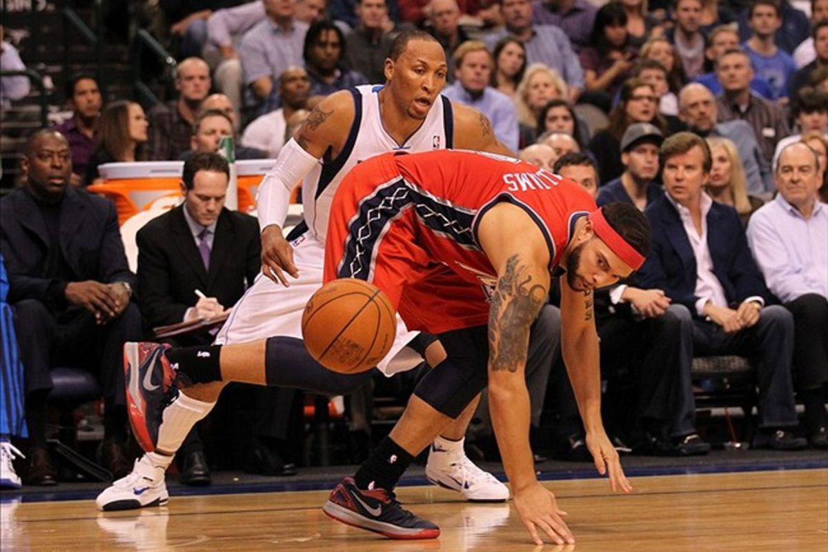 Feb 28, 2012; Dallas, TX, USA; New Jersey Nets guard Deron Williams (8) looses control of the ball against Dallas Mavericks forward Shawn Marion (0) at American Airlines Center.  Mandatory Credit: Matthew Emmons-US PRESSWIRE