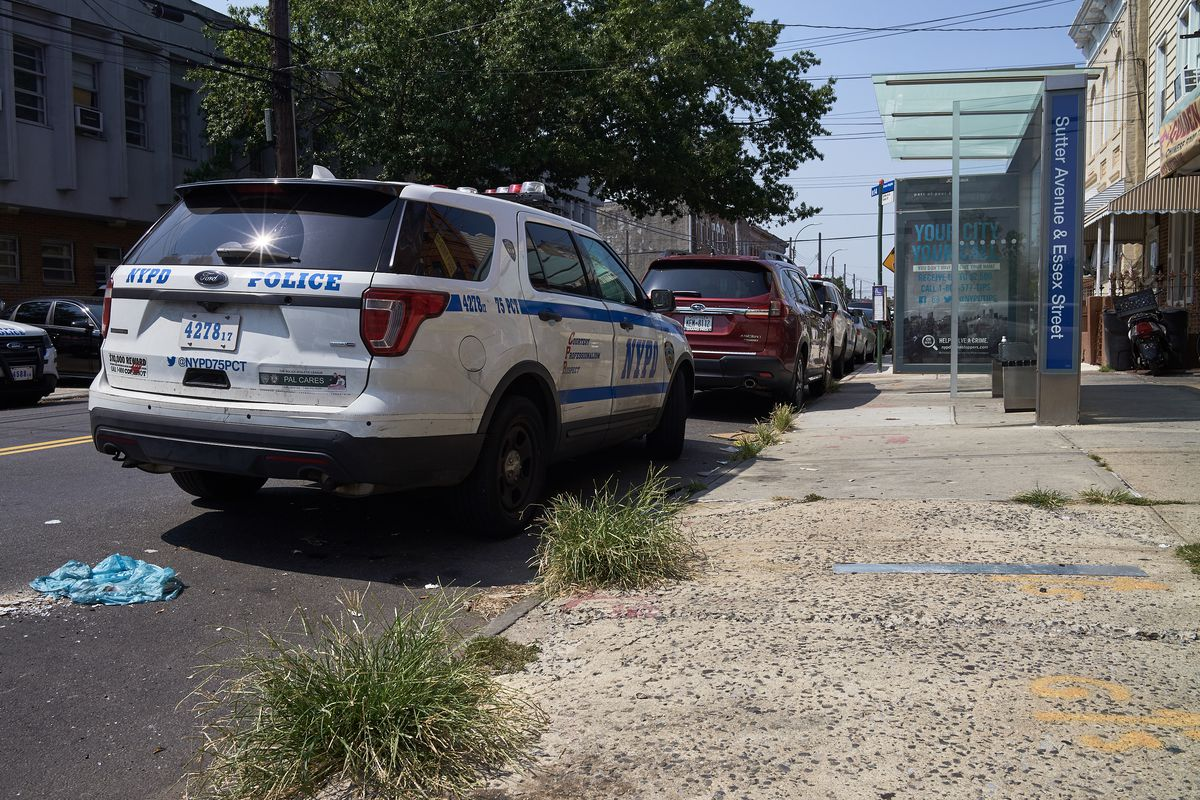 A NYPD vehicle parks at a B14 bus stop across the street from the 75th precinct in East New York on Aug. 25, 2020.