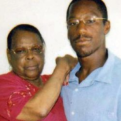 This undated image provided by Deirdre O'Connor shows John Edward Smith posing with his grandmother, Laura Neal. Prosecutors are going to court Friday Sept. 21, 2012 to seek dismissal of charges against a former gang member convicted of a drive-by murder in a gang infested neighborhood of Los Angeles 19 years ago.
