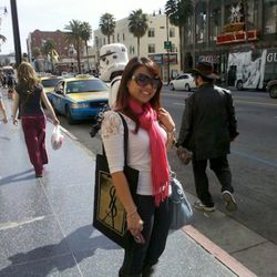 A happy camper at Hollywood and Highland. Note the stormtrooper behind her.