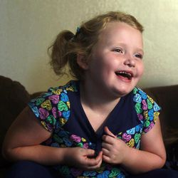 """In this photo taken Monday, Sept. 10, 2012, seven-year-old beauty pageant regular and reality show star Alana """"Honey Boo Boo"""" Thompson gestures during an interview in her home in McIntyre, Ga. The reality show """"Here Comes Honey Boo Boo"""" has been a ratings winner in recent weeks, capitalizing on redneck stereotypes and the oversized personality of Thompson."""