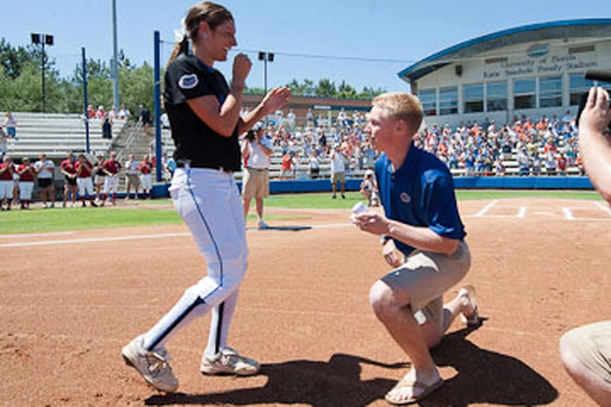 UF outfielder Francesca Enea is proposed to by Christian Bruey before Sunday's game. Also, stirrups and white spikes > sandals.