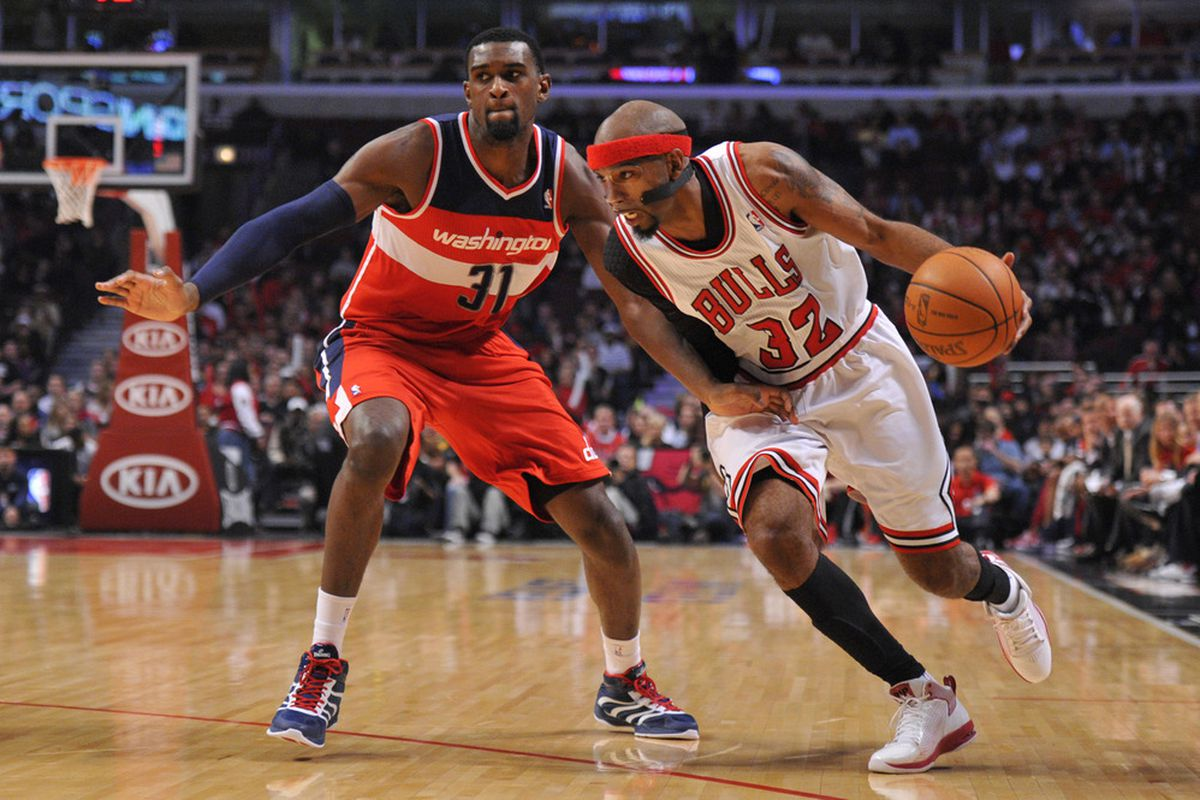 April 16, 2012; Chicago, IL, USA; Chicago Bulls shooting guard Richard Hamilton (32) is defended by Washington Wizards small forward Chris Singleton (31) during the first quarter at the United Center.  Mandatory Credit: Rob Grabowski-US PRESSWIRE