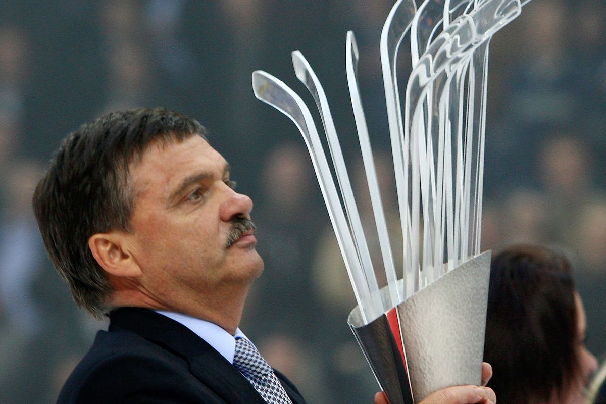 Not the worlds, but still a delightfully awkward picture of the IIHF head awarding an ugly trophy.