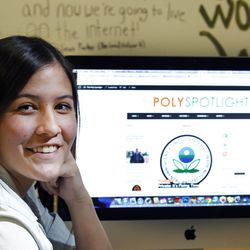 Ashley Gore, Poly High School student and editor of her school's newspaper, poses in front of the school newspaper website The Poly Spotlight during class on Feb. 16, 2016, in the city of Riverside.
