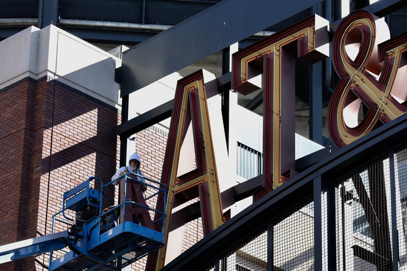Dan Williams, a sign installer with ADART sign company, prepares to measure the letter A at the main entrance gateway at Oracle Park in San Francisco, Calif., on Tuesday, February 5, 2019. Oracle Park is in the process of removing AT&T signage in front of