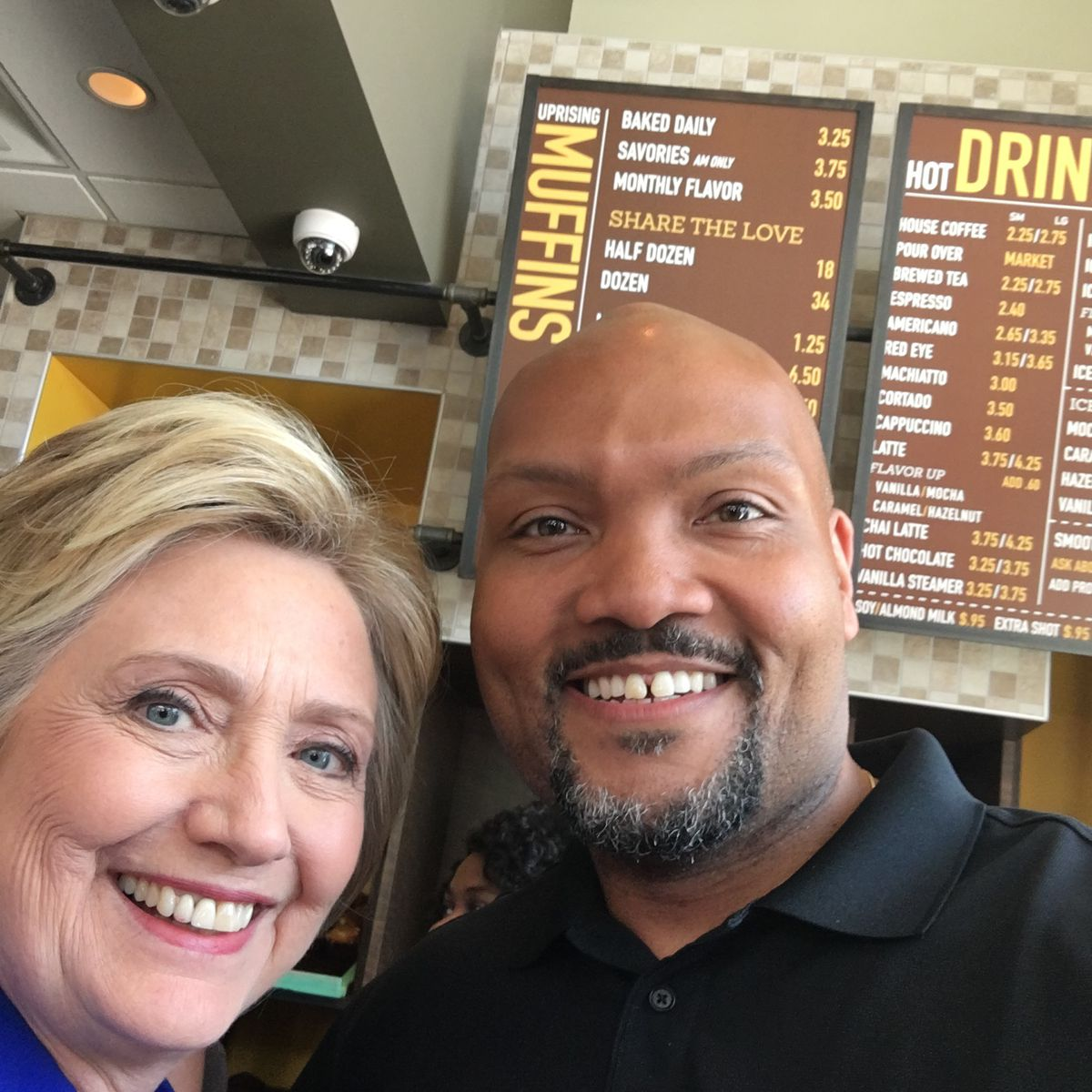 Clinton with Uprising Muffins co-owner Donnie Simpson [Photo: Official]