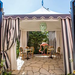 The charming outdoor patio is Chateau Marmont-meets-Beverly Hills Hotel.
