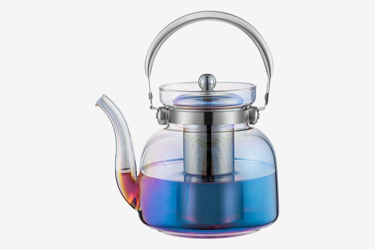 An iridescent glass tea kettle