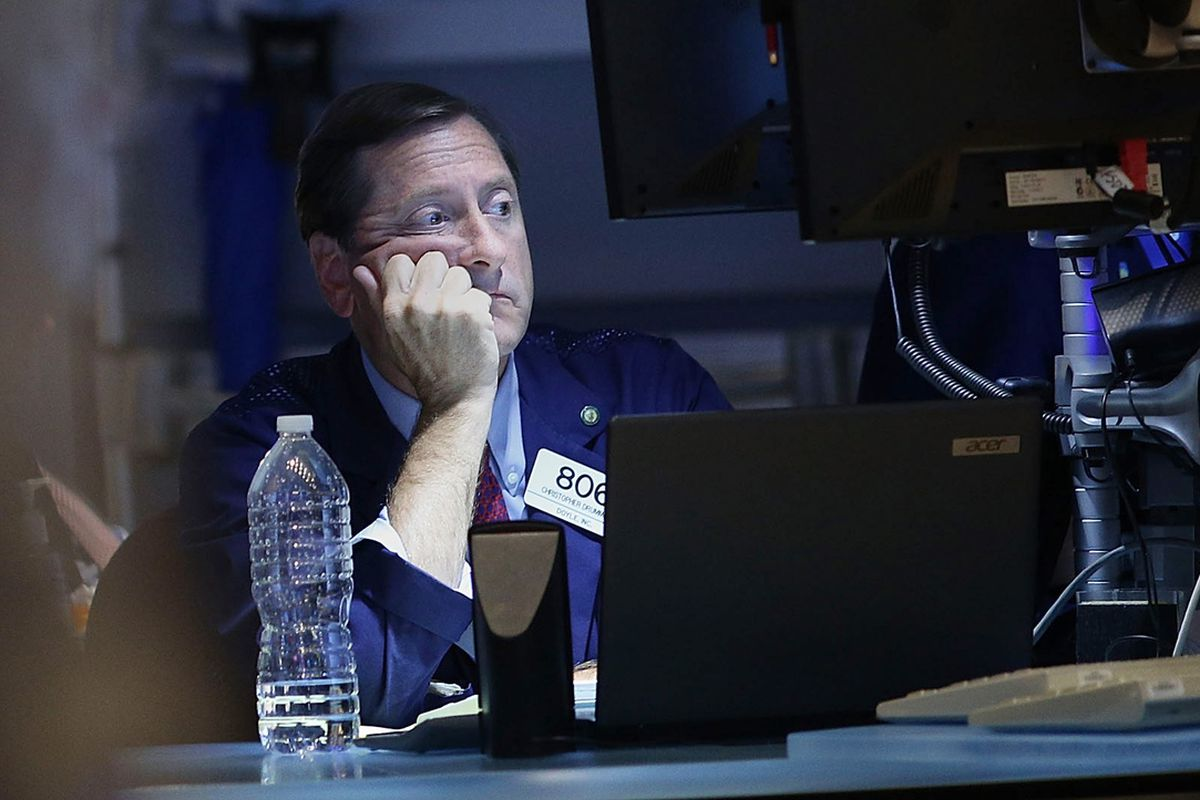 This stock trader sure looks bored. It's OK, buddy. We don't blame you.