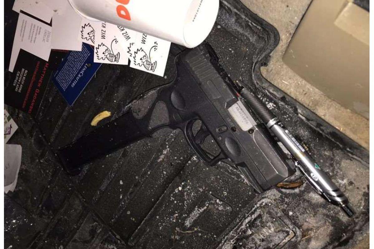 A black Taurus 9mm pistol allegedly found in a Mercedes Benz stolen Feb. 12, 2021, in Orland Park.