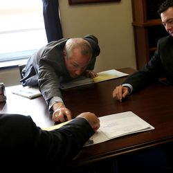 Oversight and Government Reform Committee Chairman Rep. Jason Chaffetz, R-Utah, right, meets with staff members including his staff director, Andrew Arthur, left, at the U.S. Capitol in Washington, D.C., on Tuesday, Dec. 8, 2015.