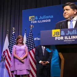 Gubernatorial candidate J.B. Pritzker's wife, M.K. Pritzker, looks on as her husband speaks at the Marriott Marquis Chicago. | Ashlee Rezin/Sun-Times