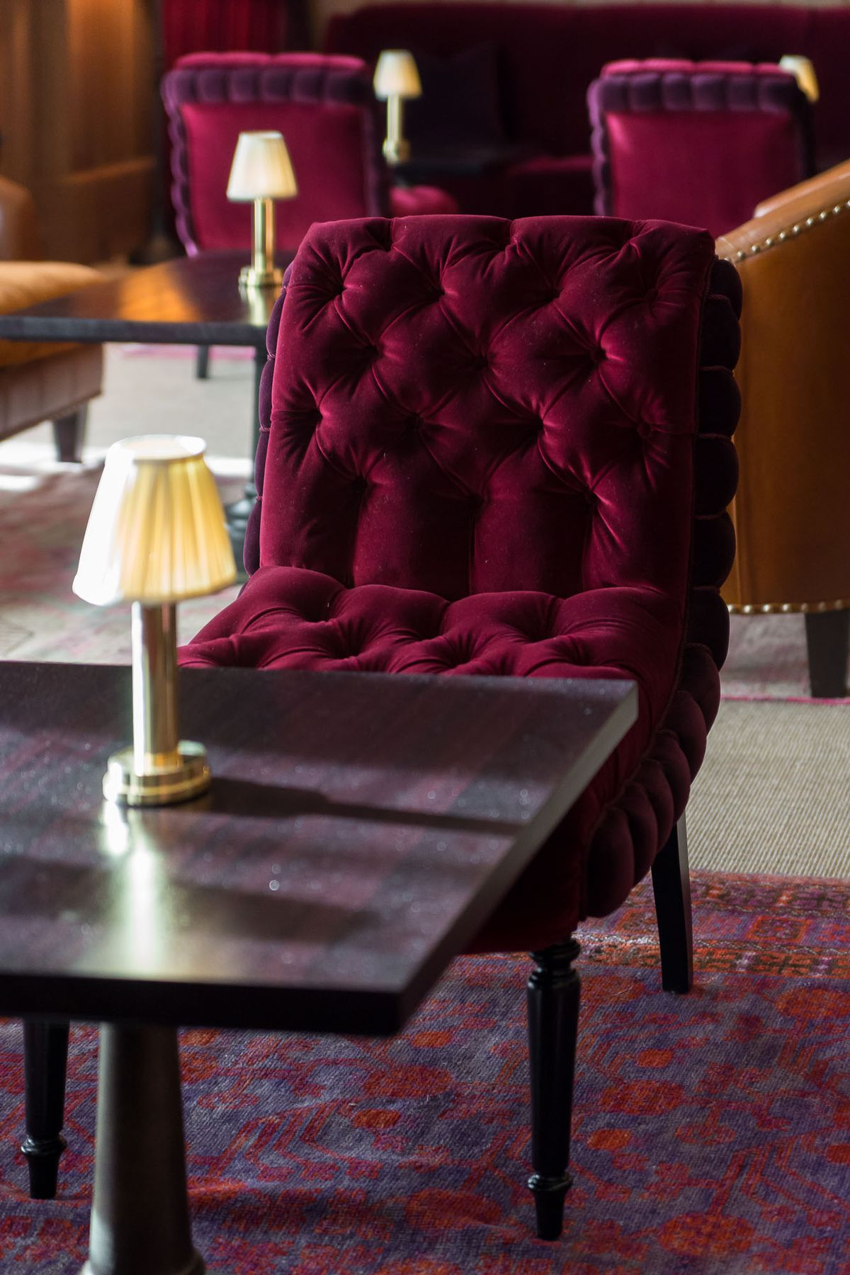 Oxblood red velvet chairs at NoMad Bar