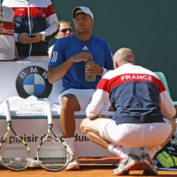 French tennis team captain Guy Forget, speaksto French  player Jo-Wilfried Tsonga during his match against U.S. player John Isner, in the quarterfinal of the Davis Cup between France and U.S. in Monaco Sunday April 8, 2012. John Isner won the match and qualifies the U.S. team for the semi-final.