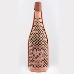 Fresh to the Chicago market is Beau Joie, a new luxury champagne encased in a 100% copper, hand-crafted suit of armor. It's a 60% Pinot Noir and 40% Chardonnay blend from France. The suit of armor helps the bottle stay colder longer and a better grip, not