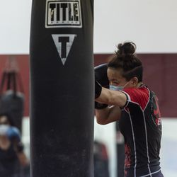 Lan Phan, a student at EFK Martial Arts, 5951 N. Clark St., hits the bag assigned to her, during a boxing class on the first day of Illinois' Phase 4 reopening, Friday, June 26, 2020.