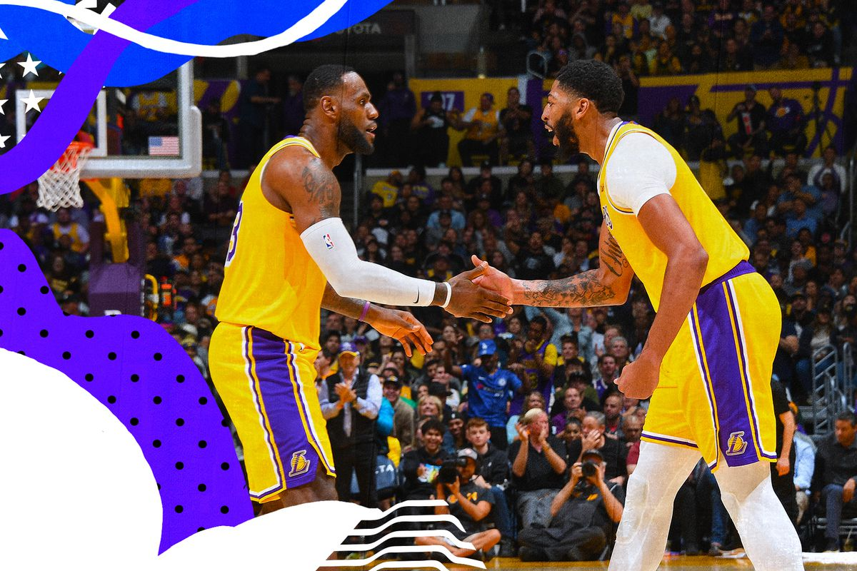 LeBron James and Anthony Davis greet each other at mid-court for the Lakers.